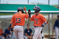 GCL Astros Jose Alvarez (6) high fives Jose Mendoza (13) after hitting a home run during a Gulf Coast League game against the GCL Marlins on August 8, 2019 at the Roger Dean Chevrolet Stadium Complex in Jupiter, Florida.  GCL Marlins defeated GCL Astros 5-4.  (Mike Janes/Four Seam Images)