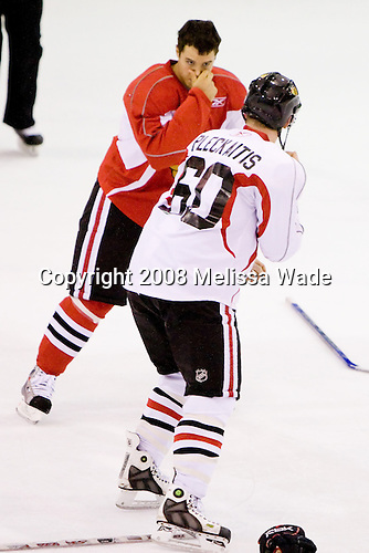 Dan Bertram (Red 14), Joe Pleckaitis (White 60) - Prospects and free agents took part in the 2008 Chicago Blackhawks Prospects Camp at Edge Ice Arena in Bensenville, Illinois, on Thursday, July 10, 2008.