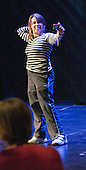 "One of the athletes takes a self-portrait during a break in rehearsals.  Special Olympics Surrey put on a show,   ""Beyond the Stars"", at the Rose Theatre, Kingston upon Thames to raise money for the  SOGB team.  The Special Olympics are for athletes with learning disabilities."