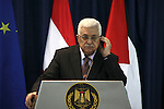 Palestinian President Mahmoud Abbas and Austrian Chancellor Werner Faymann (not seen) hold a joint news conference in the West Bank city of Ramallah on June 24, 2010. Photo by Eyad Jadallah