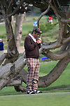 George Lopez lighting cigar at Monterey Peninsual CC
