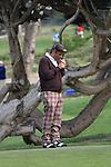 George Lopez lighting cigar at Monterey Peninsual CC