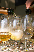 Wine glasses. Pouring cava. Mas Comtal, Avinyonet, Penedes, Catalonia, Spain