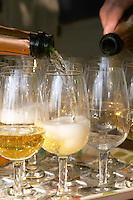 Wine glasses. Pouring cava. Mas Comtal, Avinyonet, Penedes, Catalonia, Spain