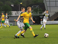 Jamie Lindsay being pressured by Adam Brown in the St Mirren v Celtic Scottish Professional Football League Under 20 match played at St Mirren Park, Paisley on 30.4.14.