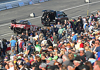 Feb 8, 2020; Pomona, CA, USA; The car of NHRA funny car driver Alexis DeJoria is towed back in front of the crowd after racing during qualifying for the Winternationals at Auto Club Raceway at Pomona. Mandatory Credit: Mark J. Rebilas-USA TODAY Sports