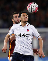 Calcio, Serie A: Roma vs Bologna. Roma, stadio Olimpico, 11 aprile 2016.<br /> Roma's Miralem Pjanic, left, and Bologna's Sergio Floccari eye the ball during the Italian Serie A football match between Roma and Bologna at Rome's Olympic stadium, 11 April 2016.<br /> UPDATE IMAGES PRESS/Isabella Bonotto