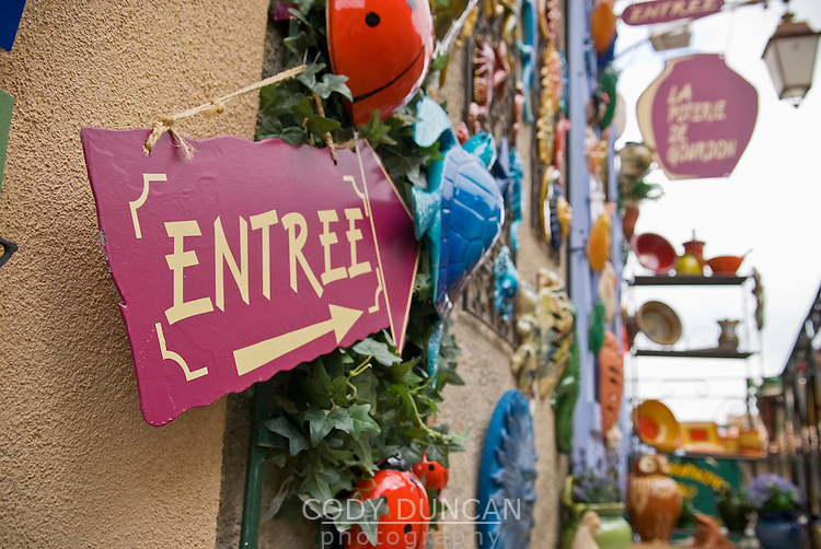 entrance sign to tourist shop in Gourdon, France
