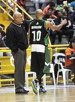 BOGOTA - COLOMBIA: 10-07-2014: Guillermo Moreno (Izq.), entrenador de Aguilas de Tunja, da instrucciones a Eddy Barlow (Der.), jugador de las Aguilas durante partido entre Guerreros de Bogota y Aguilas de Tunja por la fecha 3 de la Liga Directv Profesional de Baloncesto II en partido jugado en el Coliseo El Salitre de la ciudad de Bogota. / Guillermo Moreno (L), coach of Aguilas of Tunja, gives instructions to Eddy Barlow (R), player of las Aguilas during a match between Guerreros de Bogota and Aguilas of Tunja, for the  date 3 of La Liga Directv Profesional de Baloncesto II, game at the El Salitre Coliseum in Bogota City. Photo: VizzorImage / Luis Ramirez / Staff.