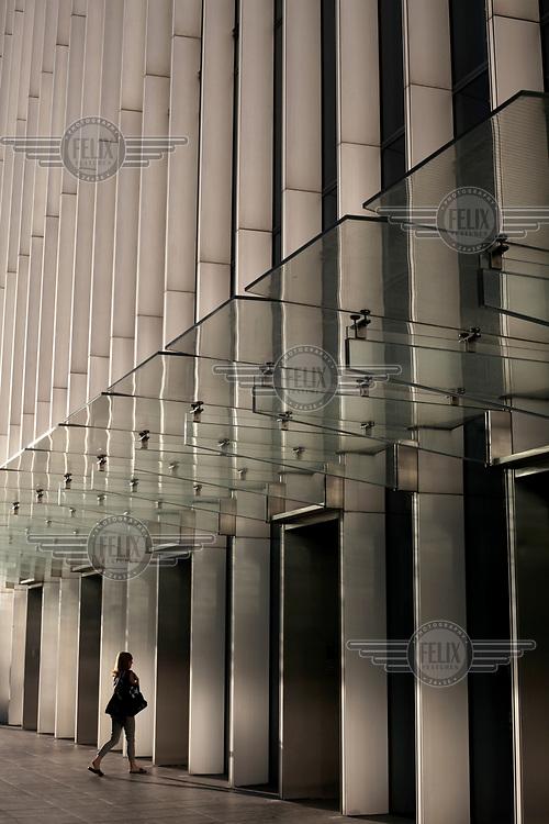A woman walks into an office building near Canary Wharf.