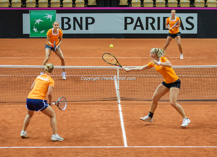 13 April, 2016, France, Trélazé, Arena Loire,   Semifinal FedCup, France-Netherlands, Dutch team practise, doubles, Kiki Bertens hits a volley with Richel Hogenkamp,  on the other side of the net Arantxa Rus (L) and Cindy Burger<br /> Photo: Henk Koster/tennisimages