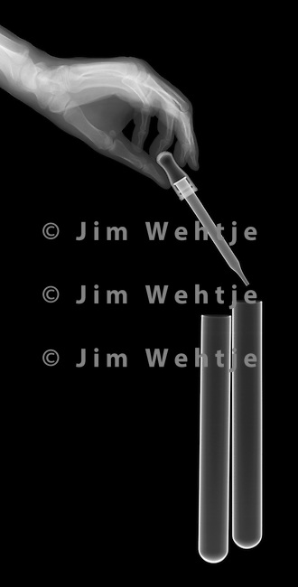 X-ray image of test tubes with dropper (white on black) by Jim Wehtje, specialist in x-ray art and design images.