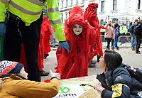 Environmental activists from Extinction Rebellion with two protesters who are under arrest during the protest in London on 09 October 2019 in London, England.<br /> .<br /> Protesters plan to blockade the London government district for a two week period, as part of 'International Rebellion' taking place in over 60 cities around the world, calling for decisive and immediate action from governments in the face of climate and ecological emergency. <br /> .<br />  Photo by Alan  Stanford.