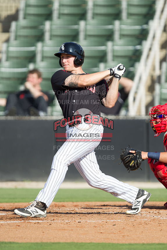 Carl Thomore (13) of the Kannapolis Intimidators follows through on his swing against the Hagerstown Suns at CMC-Northeast Stadium on May 31, 2014 in Kannapolis, North Carolina.  The Intimidators defeated the Suns 3-2 in game one of a double-header.  (Brian Westerholt/Four Seam Images)
