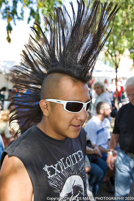 Forrest Tilla was acheeky participant in the  Native American constume constest with his giant Mohawk hair do  during the  Santa Fe Indian Market.