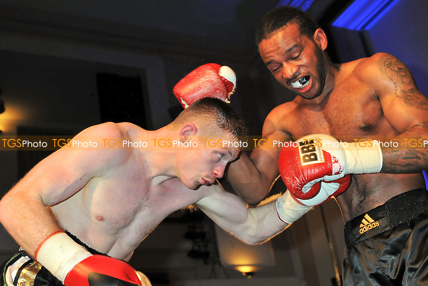 Joe Duffy (black shorts) defeats Gilson de Jesus in a Super-Middleweight boxing contest at the Camden Centre, London, promoted by Mickey Helliet - 23/03/13 - MANDATORY CREDIT: Philip Sharkey/TGSPHOTO - Self billing applies where appropriate - 0845 094 6026 - contact@tgsphoto.co.uk - NO UNPAID USE.