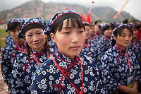 Female competitors dressed as revolutionary volunteers  participate in the Red Games. Held in Junan County, this sporting event is a nostalgic tribute to the communist era.