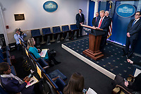 United States President Donald J. Trump delivers remarks on the COVID-19 (Coronavirus) pandemic alongside members of the Coronavirus Task Force in the Brady Press Briefing Room at the White House in Washington, DC, March 25, 2020, in Washington, D.C. <br /> Credit: Sarah Silbiger / Pool via CNP/AdMedia