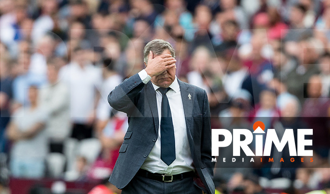Everton Manager Sam Allardyce covers his face during the Premier League match between West Ham United and Everton at the Olympic Park, London, England on 13 May 2018. Photo by Andy Rowland / PRiME Media Images.