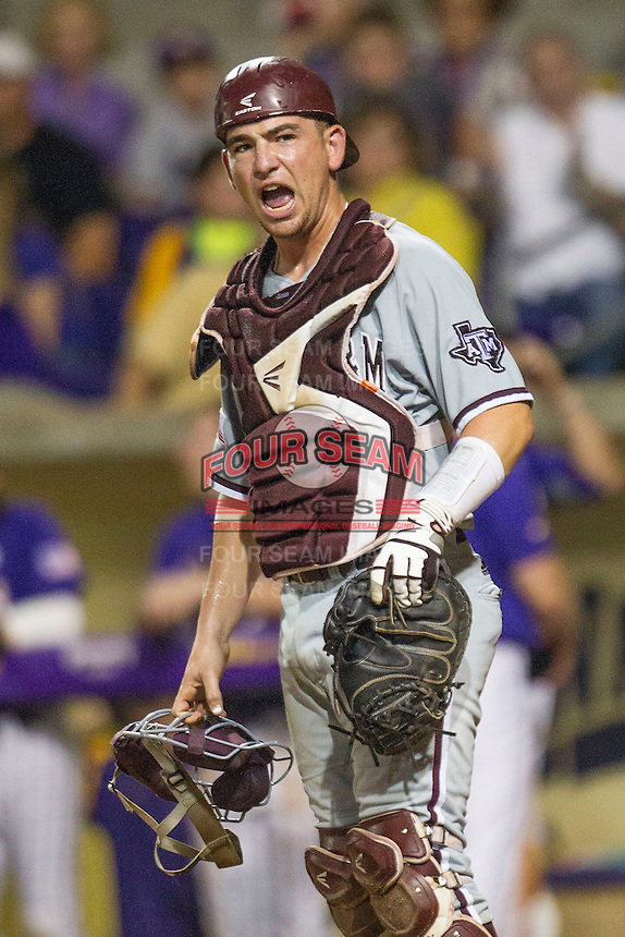 Texas A&M Aggies catcher Michael Barash (5) in pain after getting hit by a bat during a Southeastern Conference baseball game against the LSU Tigers on April 24, 2015 at Alex Box Stadium in Baton Rouge, Louisiana. LSU defeated Texas A&M 9-6. (Andrew Woolley/Four Seam Images)