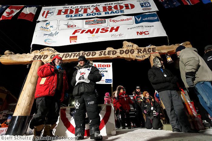 Dallas Seavey talks with Leo Rassumuson after winning his 3rd Iditarod in 8 days 18 hours 13 minutes 6 seconds with lead dogs Reef and Hero on Wednesday March 17, 2015 during Iditarod 2015.  <br /> <br /> (C) Jeff Schultz/SchultzPhoto.com - ALL RIGHTS RESERVED<br />  DUPLICATION  PROHIBITED  WITHOUT  PERMISSION