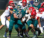 SPEARFISH, SD - SEPTEMBER 17: Phydell Paris #34 of Black Hills State tries to pick up extra yards while surrounded by Dixie State defendersduring their college football game Saturday September 17, 2016 at Lyle Hare Stadium in Spearfish, S.D.  (Photo by Dick Carlson/Inertia)