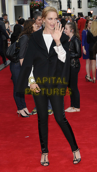 Uma Thurman<br /> 'Charlie And The Chocolate Factory' press night, Theatre Royal, Drury Lane, London, England.<br /> 25th June 2013<br /> full length black trousers cape poncho jacket white top hand arm palm waving mouth open<br /> CAP/CAN<br /> &copy;Can Nguyen/Capital Pictures