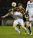 Alloa's Stephen Simmons goes through the back of Raith Rovers' Jason Thomson.