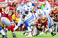 Landover, MD - September 16, 2018: Indianapolis Colts running back Nyheim Hines (21) avoids a tackle by Washington Redskins linebacker Mason Foster (54) on his way to a touchdown during game between the Indianapolis Colts and the Washington Redskins at FedEx Field in Landover, MD. The Colts defeated the Redskins 21-9.(Photo by Phillip Peters/Media Images International)