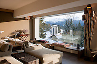 The chalet has stunning views of the mountains surrounding Cortina D'Ampezzo from a large picture window in the open plan living room