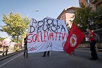 Manifesto popolo d'europa sollevatevi durante lo Sciopero Nazionale della CGIL, in Abruzzo il corteo della protesta si è svolta nella zona rossa della città de L'Aquila ad un anno dal terremoto. 25/06/2010 Photo: Adamo Di Loreto/BuenaVista*Photo