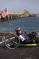 Morehead City, NC -- Portrait of quadriplegic hand cyclist Paul Kelly, 62, who trains for the Boston Marathon Tuesday, March 27, 2018. (Justin Cook for The Wall Street Journal)<br /> <br /> SUMMARY:<br /> <br /> Paul Kelly, hand cyclist, Beaufort, NC Training for the Boston Marathon so we would want to shoot in March to run the week before the marathon or marathon Monday, Apriln16. Life as a quadriplegic doesn&rsquo;t keep 62-year-old Paul Kelly on the sidelines. After breaking his neck in a swimming accident in 1978, Kelly was determined to find fitness activities to maintain an active lifestyle. He discovered handcycles while watching his niece compete in the 2006 Marine Corps Marathon and was inspired to start his own marathon career to stay fit. Paul has competed in over 100 half and full marathons. On April 16, he will celebrate his 40th year of living as a quadriplegic by taking on one of the most coveted races for a marathoner -- the Boston Marathon. Kelly is among the 60 handcyclists competing in the 2018 Boston Marathon with a qualifying time of 1:26:37. Most of Paul&rsquo;s distance training takes place at Bogue Banks, which includes Atlantic Beach, Salter Path, and Emerald Isle, N.C. It&rsquo;s Nicholas Sparks worthy scenery with its marshes, waterways, inlets and small islands. Paul is particularly fond of the approach from Atlantic Beach to Bogue Banks -- it&rsquo;s via the high-rise bridge. In cold weather, Paul has to be mindful of the environment and dress in a manner that insulates his legs while also allowing his upper body to ventilate. Paul chooses to train at times of day when the temperatures are more reasonable. He uses hand warmers in his gloves, on the inside the grips on his handcycle and in the legs of his trousers.