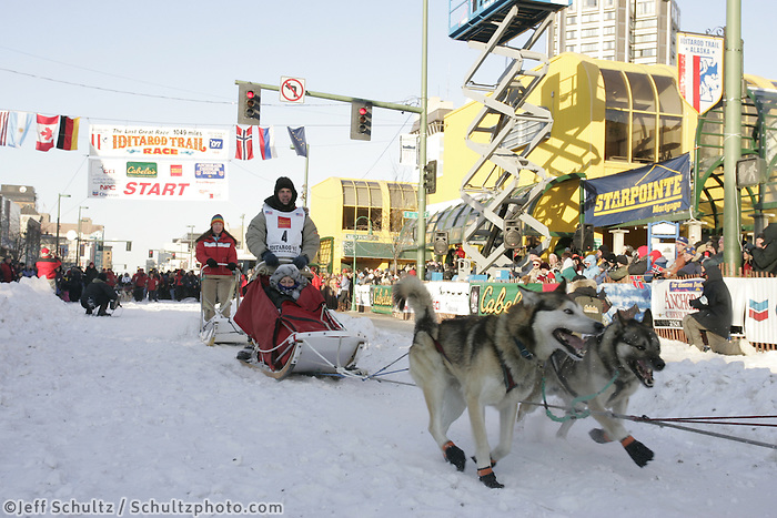 March 3, 2007   Cim Smyth leaves the start line during the Iditarod ceremonial start day in Anchorage