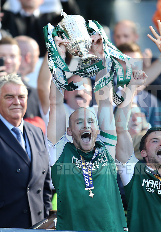 Hibernian's David Gray lifts the trophy after the William Hill Scottish Cup Final match at Hampden Park Stadium.  Photo credit should read: Lynne Cameron/Sportimage