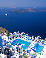 Greece; Cyclades; Santorini; Fira (Thira): Swimming Pool with view across the Caldera, cruise ship and island Nea Kameni