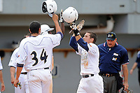 16 May 2010:  FIU's Junior Arrojo (13, right) celebrates his eighth-inning home run with Rudy Flores (34) and Pablo Bermudez (12) as the FIU Golden Panthers defeated the University of South Alabama Jaguars, 5-0, at University Park Stadium in Miami, Florida.