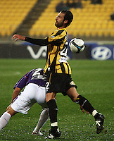 The ball gets past Phoenix captain Andrew Durante during the A-League football match between Wellington Phoenix and Perth Glory at Westpac Stadium, Wellington, New Zealand on Sunday, 16 August 2009. Photo: Dave Lintott / lintottphoto.co.nz