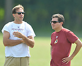 Ashburn, VA - August 6, 2009 -- Executive Vice President of Football Operations Vinny Cerrato, left, and owner Daniel Snyder, right, discuss the team during the 2009 Washington Redskins Training Camp at Redskins Park in Ashburn, Virginia on Thursday, August 6, 2009..Credit: Ron Sachs / CNP