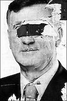 A street poster of a Macedonian presidential candidate Boris Trajkovski (now deceased) is gouged in the eyes. There are two million people residing in Macedonia, but an enormous rise in population among the Albanian population is contributing to the ethnic tensions and crimes between Albanians and Macedonians. Skopje, Macedonia, June 2000 &copy; Stephen Blake Farrington<br />