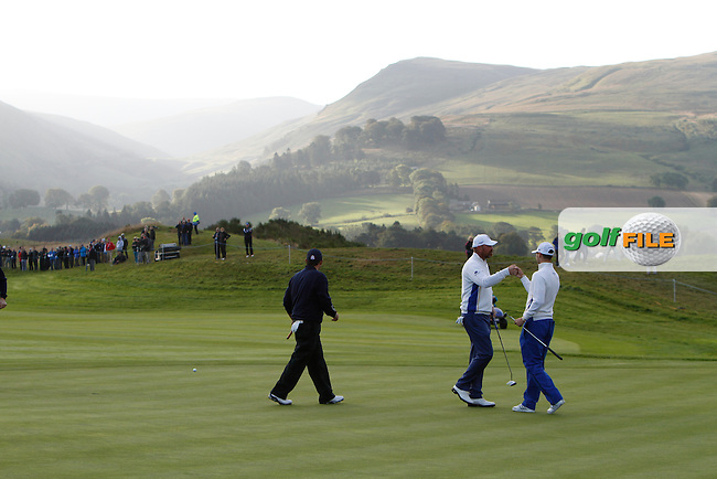 Thomas Bjorn (EUR) and Martin Kaymer (EUR) on the 3rd green during the Saturday Fourball Matches of the Ryder Cup at Gleneagles Golf Club on Saturday 27th September 2014.<br /> Picture:  Thos Caffrey / www.golffile.ie