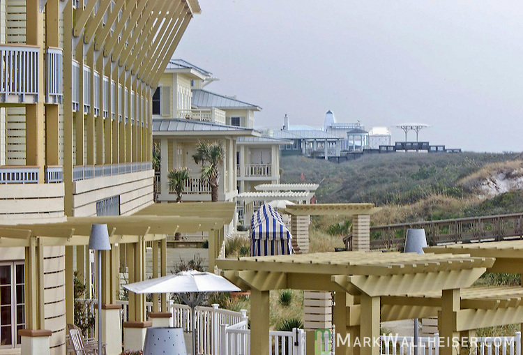 The Gulf side of the Watercolor Inn (L) shows how it is set back from the dunes as opposed to their neighbors, Seaside (R).The face of WaterColor changes daily.  WaterColor is a St Joe Company development along the Emerald Coast in Walton County in the Florida panhandle.  WaterColor is an upscale development and is located near Grayton Beach and Seaside between Panama City and Destin.