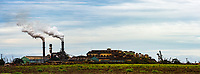 Maui A&B Sugar Plantation smoke stacks under dramatic light shortly before the plantation closed for business.