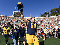 Mark Brazinski of California waves to the fan during Senior Day before NCAA football game against USC at Memorial Stadium in Berkeley, California on November 9th, 2013.   USC defeated California, 62-28.