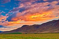 Stormy clouds over grasslands at sunrise, Cache Creek, British Columbia, Canada
