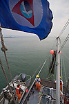 Puget Sound, marine research, Washington State, NOAA flag, National Marine Fisheries Service, NMFS, marine, research scientists trawl net to monitor diseases of fish in Puget Sound, Skagit Bay, aboard the research vessel Harold W. Streeter