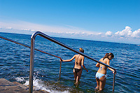 2 girls going into the sea for a swim , Slovenia