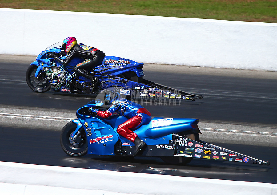 May 7, 2017; Commerce, GA, USA; NHRA pro stock motorcycle rider L.E. Tonglet (far) defeats Scotty Pollacheck during the Southern Nationals at Atlanta Dragway. Mandatory Credit: Mark J. Rebilas-USA TODAY Sports