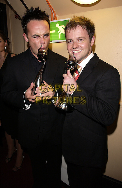 ANT McPARTLIN & DECLAN DONNELLY.10th Anniversary National Television Awards, Royal Albert Hall, London, October 26th 2004..half length trophy award Ant & Dec funny.Ref: FIN.www.capitalpictures.com.sales@capitalpictures.com.©Steve Finn/Capital Pictures .