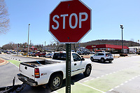 NWA Democrat-Gazette/DAVID GOTTSCHALK Traffic passes through stop signs Friday, March 15, 2019, within the Fiesta Square parking lot in Fayetteville. The first concept maps for Fayetteville's 71B corridor project were released Thursday. A roundabout is suggested at Fiesta Square, which would connect extensions of Appleby Road and Plainview Avenue.