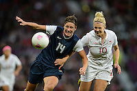 Manchester, England - Monday, August 6, 2012: The USA defeated Canada 4-3 in overtime in the semi-final round of the 2012 London Olympics at Old Trafford. Abby Wambach (14) and Lauren Sesselmann (10) battle for the ball.
